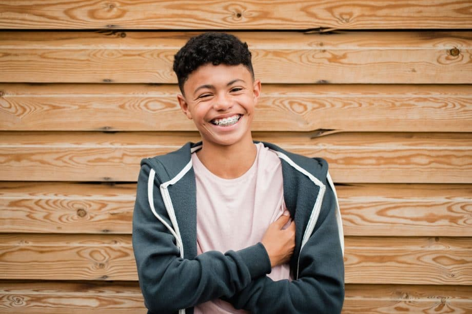 young teen boy with braces, smiling