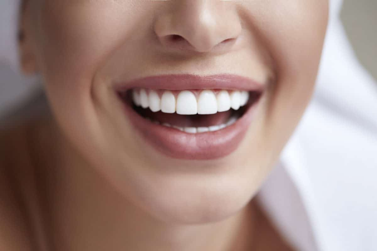 Close Up Of Woman Smiling With Straight Teeth