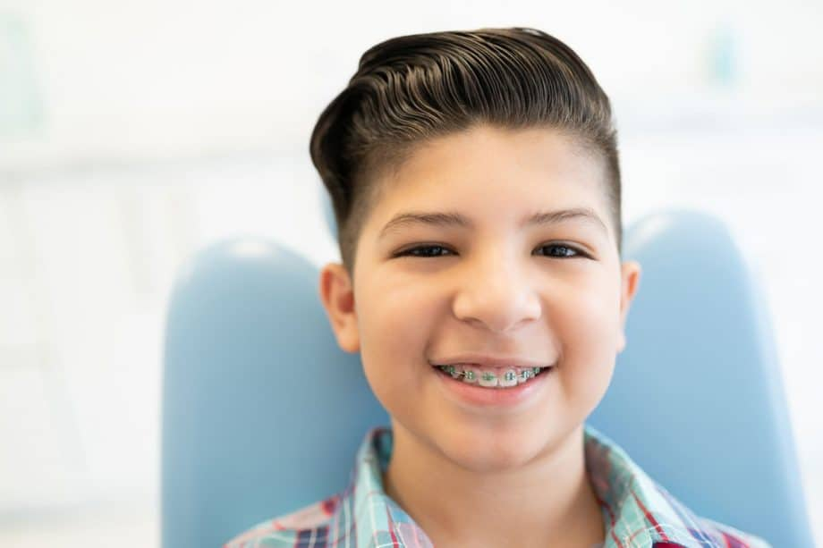 young boy with braces, smiling